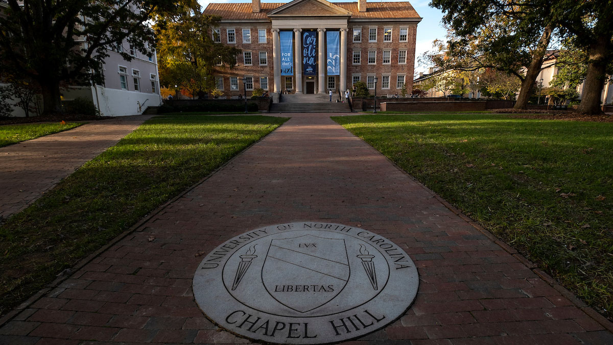 The UNC seal with South Building in the background.