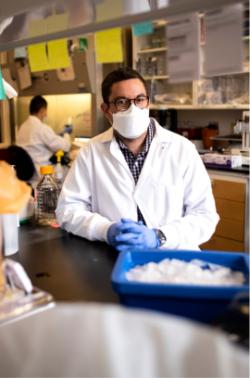 David Martinez standing in lab